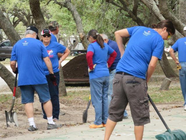 Work party to restore an RV park shuffleboard court
