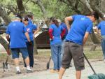 Work party to restore an RV park shuffleboard court